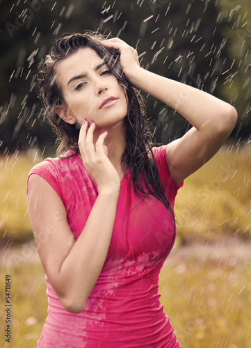 Sexy woman in summer raindrops