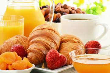 Breakfast with croissants cup of coffee and fruits