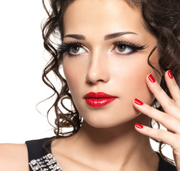 Beautiul fashion woman with red manicure and lips