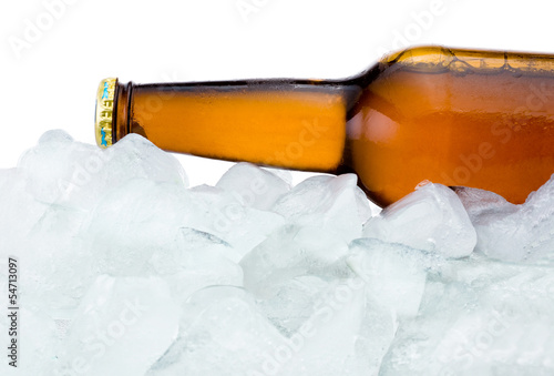 Close-up Brown bottle with Condensation cool in ice isolated on