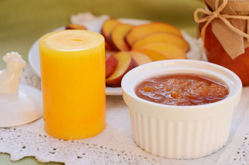 Homemade peach jam in white bowl