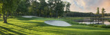 Fototapety Panoramic view of golf green with white sand traps