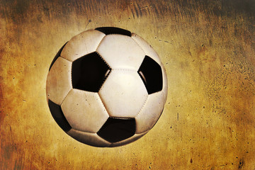 Traditional soccer ball on grunge textured background