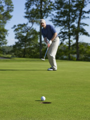 Golfer sinks putt on green