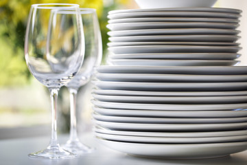 White plates and wine glasses