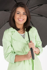 Beautiful women with umbrella. Attractive young women holding an