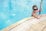 girl in the water pool in sunglasses