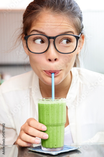 Green vegetable smoothie juice - woman drinking