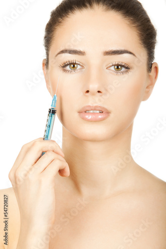 young brunette woman holding syringe