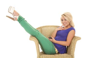 woman green pants headphones legs up