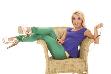 woman green pants headphones open mouth