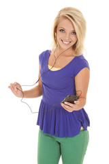 woman green pants headphones smile
