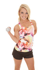 woman in a colorful tank fitness curl