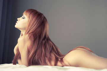 Sensual woman in bed