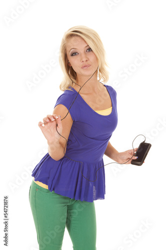 woman green pants headphones spunky