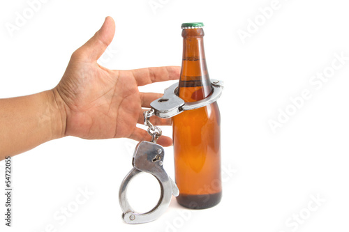 bottle beer and handcuffs,Drunk driving concept