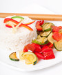 Plate of vegetable fried rice and chopstick