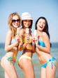 girls in bikini with ice cream on the beach
