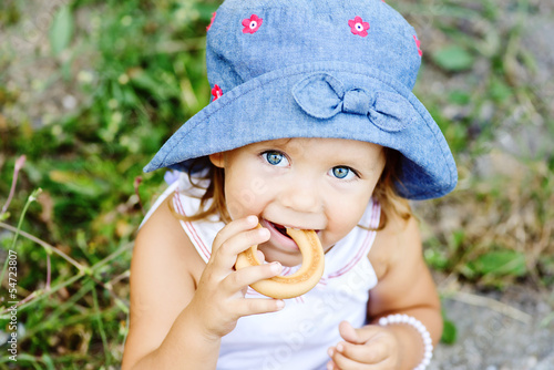 toddler girl eating cracknel