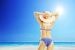 Attractive blond woman in a bikini on a beach