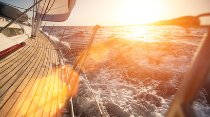 Yacht sailing during sunset.