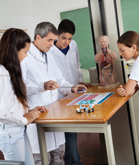 Teacher Teaching Experiment To Students In Lab