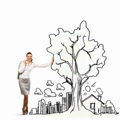 Businesswoman leaning on illustration