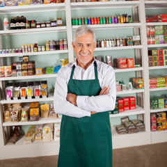 Store Owner Smiling In Supermarket