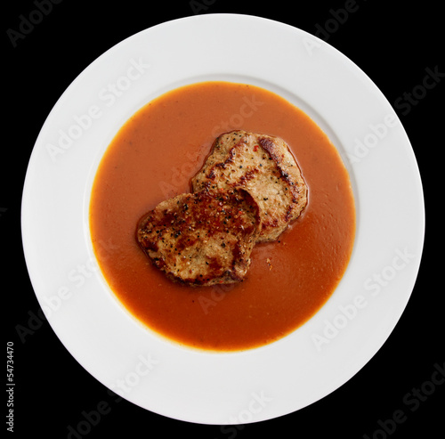 Fried pork with thick sauce in plate