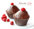 Chocolate fruitcakes covered with raspberry on white background