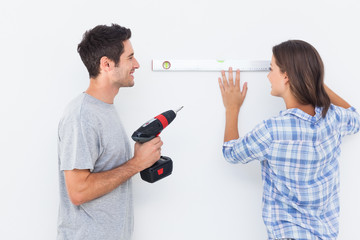 Man and his wife doing diy together