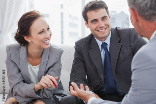 Businessman talking to his partners