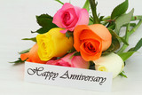 Happy Anniversary note with colorful bouquet of roses