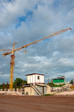 Crane and Temporary houses for worker near construction place. poster
