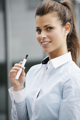 portrait of young woman smoking electronic cigarette