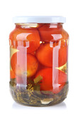 Tasty canned tomatoes in glass jar, isolated on white