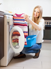 woman with clothes near washing machine