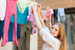 Girl hanging clothes   on clothesline