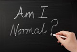 Am I Normal? written on a blackboard