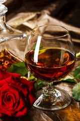 Vintage cognac with rose