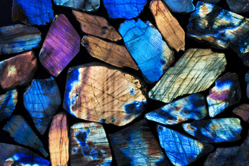 Many colorful natural labradorite gem stones.