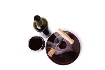 Decanter, bottle and glass with red wine top view.