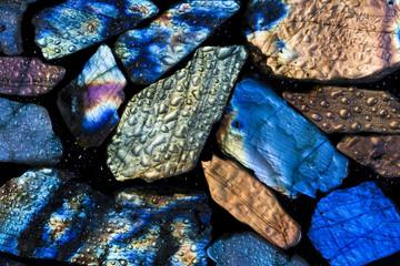 Colorful wet labradorite gem stones.