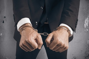 Businessman handcuffed