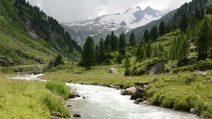 Time lapse of clouds and Stream water at Zillertal alps