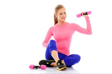 Beautiful girl doing fitness exercise with dumbbells