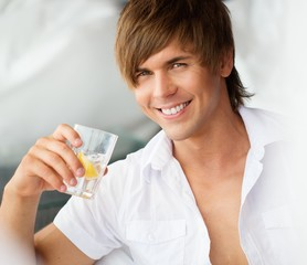 Handsome smiling young man with glass