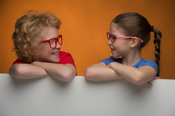 Happy children. Cheerful children in glasses looking at each oth