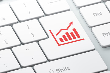 Finance concept: Growth Graph on computer keyboard background