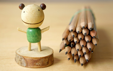 Pencil set with decorated wooden toy